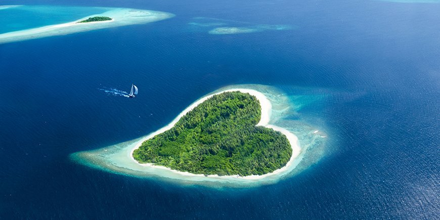 heart island in the maldivian tropical sea